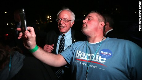 DES MOINES, IA - NOVEMBER 14:  A supporter takes a selfie with Democratic presidential candidate Sen. Bernie Sanders (I-VT) after a watch party for the second Democratic presidential debate November 14, 2015 in Des Moines, Iowa. Sanders joined Hillary Clinton and Martin O'Malley in the party's second presidential debate.  (Photo by Alex Wong/Getty Images)
