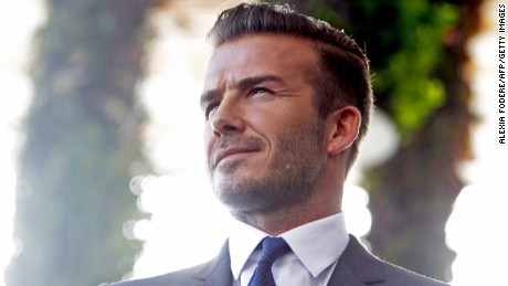 Former  England and Manchester United star, David Beckham during a press conference at the Perez Art Museum Miami, in Miami, Florida on February 5, 2014. Beckham said Wednesday that he will buy a US team to play Major League Soccer and bring it to Miami, confirming the worst-kept secret in world football. Beckham spoke to reporters alongside MLS commissioner Don Garber(L), who said Beckham and the league would work with Miami Dade county to build a world-class downtown stadium for the new club. AFP PHOTO / Alexia FODERE        (Photo credit should read Alexia Fodere/AFP/Getty Images)