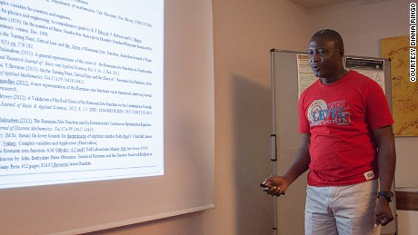 Opeyemi Enoch presenting his solution at the International Conference on Mathematics and Computer Science 2015, Vienna.
