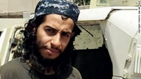 This undated image made available in the Islamic State's English-language magazine Dabiq, shows Abdelhamid Abaaoud. Abaaoud, the child of Moroccan immigrants who grew up in the Belgian capitals Molenbeek-Saint-Jean neighborhood, was identified by French authorities on Monday Nov. 16, 2015, as the presumed mastermind of the terror attacks last Friday in Paris that killed over a hundred people and injured hundreds more. (Militant Photo via AP)