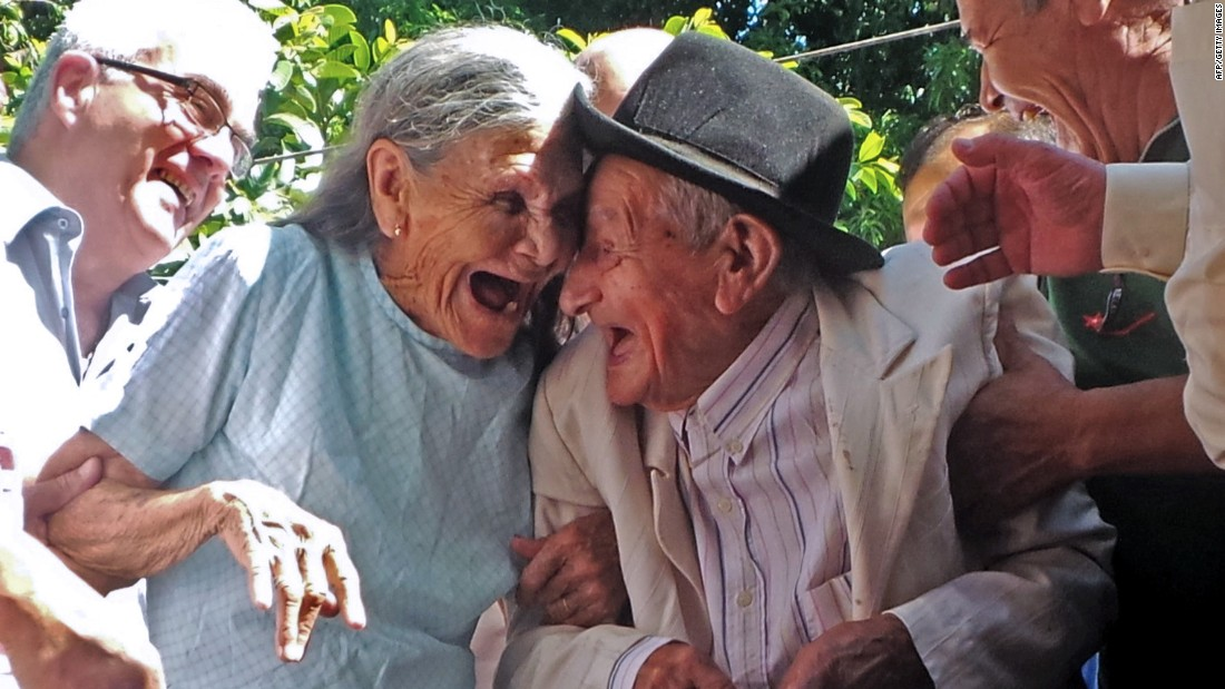 Anacleto Escobar and his wife, Cayetana Roman, laugh at a ceremony commemorating his 100th birthday Wednesday, January 7, in Neembucu, Paraguay. Escobar, a veteran of the Chaco War that was fought between Paraguay and Bolivia in the 1930s, was given a house as a gift. He and his wife had never owned their own home before.