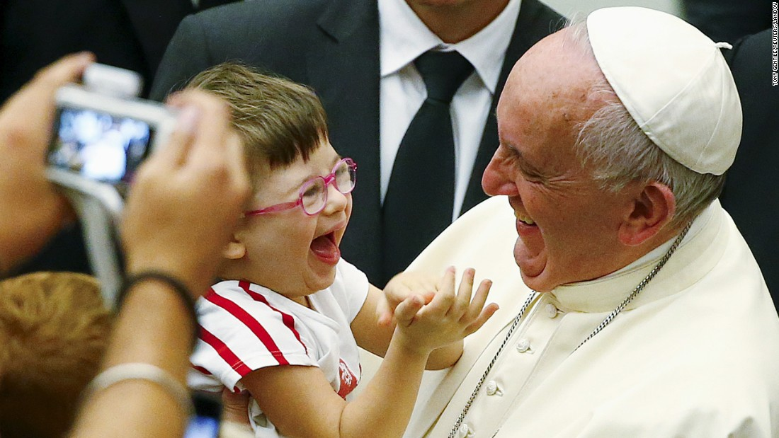 Pope Francis laughs with a child at the Vatican on Saturday, September 5.