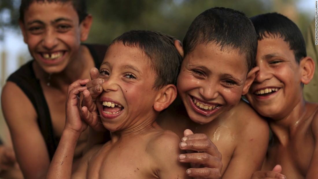 Boys play together after jumping in the Nile River to cool off Wednesday, May 27, in Cairo.