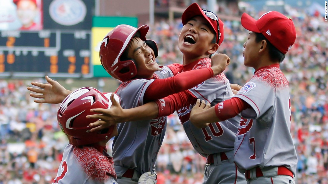 Little League baseball players from Japan celebrate after a game-winning hit to defeat Mexico on Saturday, August 29. The team would go on to beat a team from Pennsylvania and win the tournament.