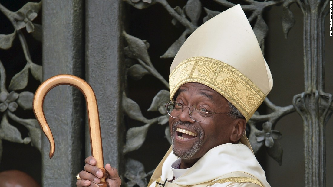 The Rev. Michael Bruce Curry laughs Sunday, November 1, as he waits for the traditional opening of the doors at the Washington National Cathedral. Curry became the first African-American to serve as presiding bishop of the Episcopal Church.