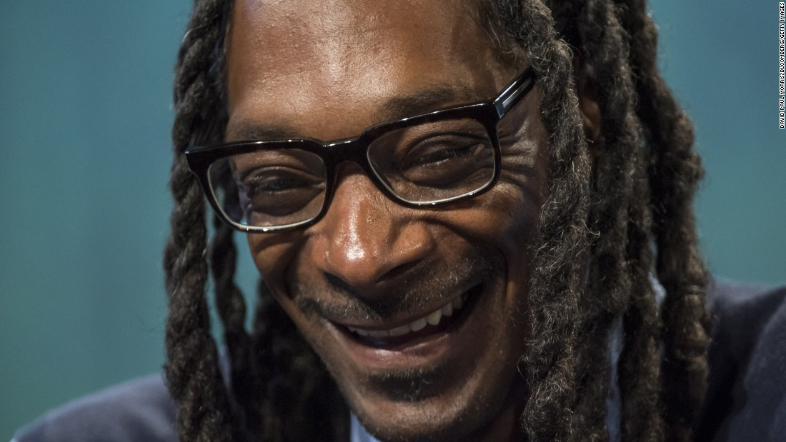 Rapper Snoop Dogg laughs during TechCrunch Disrupt, a technology conference in San Francisco, on Monday, September 21.