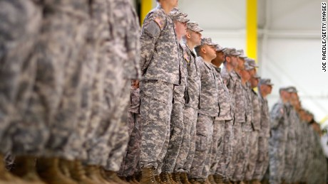 U.S. Army Florida National Guard members of the 53rd Infantry Brigade Combat Team stand in formation during a deployment ceremony on January 5, 2010 in Fort Lauderdale, Florida.