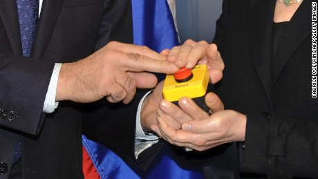 "Former US Secretary of State Hillary Clinton handed a ""reset"" button to Russian Foreign Minister Sergei Lavrov during a meeting on March 6, 2009 in Geneva."