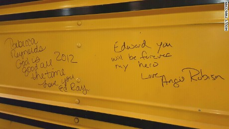Victims of the school bus kidnapping signed the bus after driver Edward Ray's death in 2012. Ray was hailed as a hero for helping the 26 children escape.