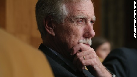 Angus King listens at a hearing