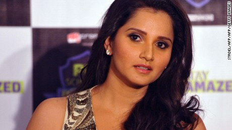 Indian tennis player Sania Mirza attends a promotional event for the Pix School of Bonding in Mumbai on November 20, 2014. AFP PHOTO/STR        (Photo credit should read STRDEL/AFP/Getty Images)