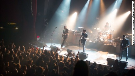 Eagles of Death Metal perform on stage at the Bataclan concert hall in Paris moments before four men armed with assault rifles stormed into the venue and opened fire on Friday, November 13.