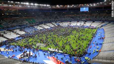 Spectators invade the Stade de France field after the match.