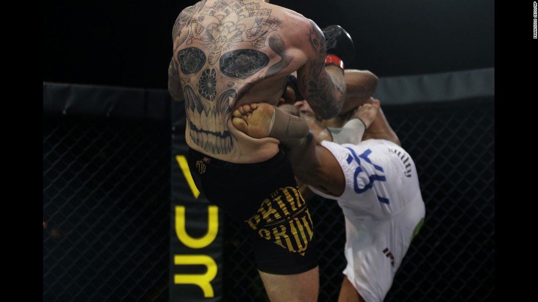 Philip Mulpeter, left, is kicked by Vitor Nobrega during their MMA bout Monday, January 26, in Estoril, Portugal. Nobrega won by decision to retain his International Pro Combat title.