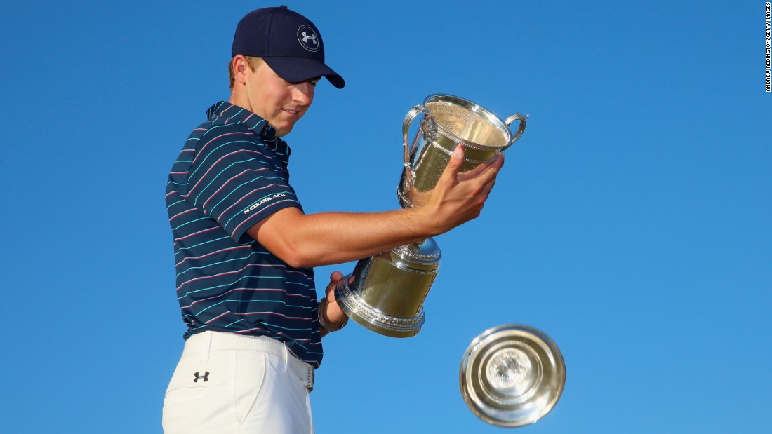 "Pro golfer Jordan Spieth loses the top of his trophy <a href=""http://www.cnn.com/2015/06/21/golf/golf-us-open-spieth/"" target=""_blank"">after winning the U.S. Open</a> on Sunday, June 21. It was the second major victory in a row for Spieth, who also won the Masters in April. At the age of 21, he became the youngest U.S. Open champion since Bobby Jones in 1923."