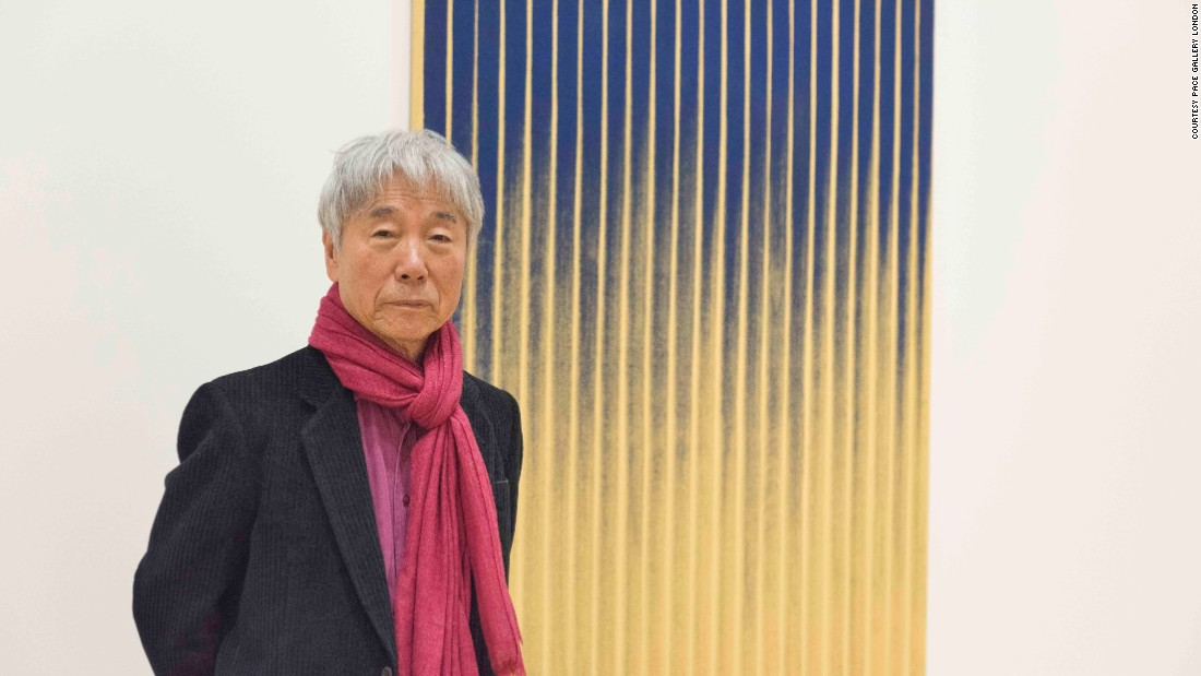"Lee Ufan stands next to a painting from the series ""From Wind"" at his recent show at London's Pace Gallery. Discover the artist's ""Tansaekhwa"" works, made in South Korea during the 1970s and early 80s -- a period of domestic political strife -- which the artist says express something ""devoid of being."""