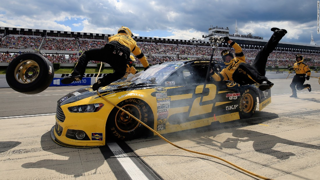 NASCAR driver Brad Keselowski accidentally crashes into two of his crew members during a Sprint Cup race Sunday, August 2, at Pennsylvania's Pocono Raceway. Neither crew member was hurt.