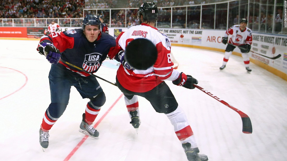 U.S. hockey player Matt Williams watches the puck hit the glass during an exhibition game against Canada on Saturday, June 6. The exhibition series, the Ice Hockey Classic, took place in Australia.
