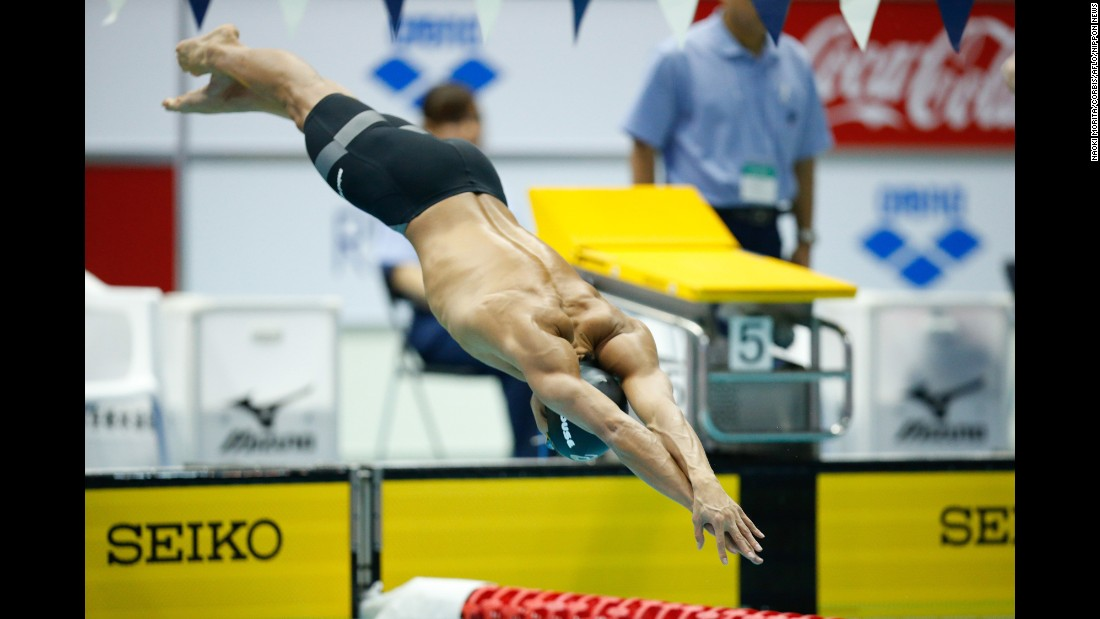 Japanese swimmer Hiromasa Fujimori dives into the water Sunday, February 22, starting an individual medley race at the Konami Open in Tokyo.