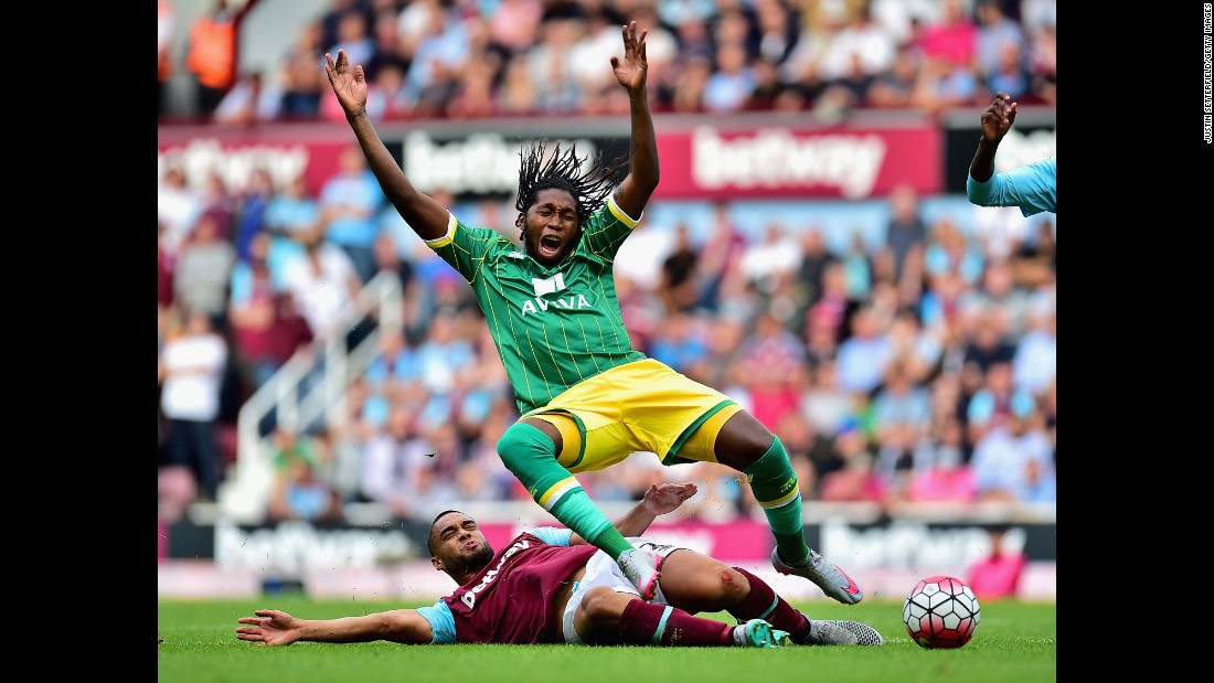 Norwich City striker Dieumerci Mbokani is tackled by West Ham's Winston Reid during a Premier League match in London on Sunday, September 26.