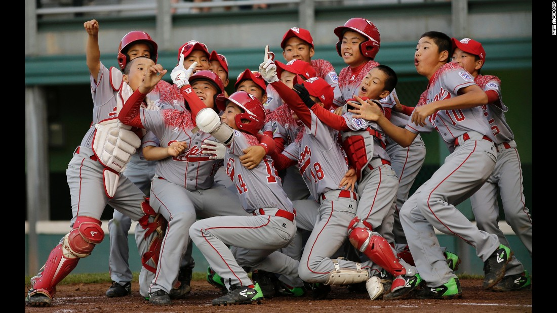 Players from Team Japan celebrate a home run with a fake selfie during the Little League World Series on Friday, August 21. They would go on to win the tournament.
