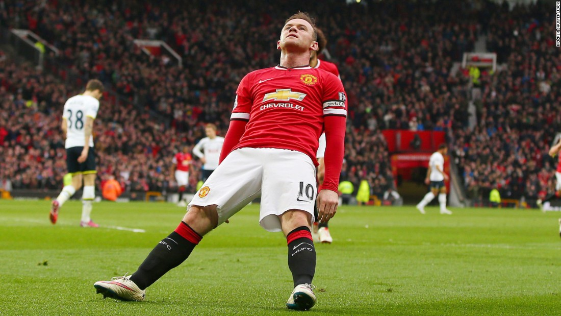 "Manchester United captain Wayne Rooney falls backward as he celebrates a goal Sunday, March 15, in Manchester, England. Rooney <a href=""http://www.cnn.com/2015/03/15/football/football-man-utd-tottenham-chelsea/"" target=""_blank"">was making light of a viral video</a> that showed him getting knocked down while playfully boxing in his home."