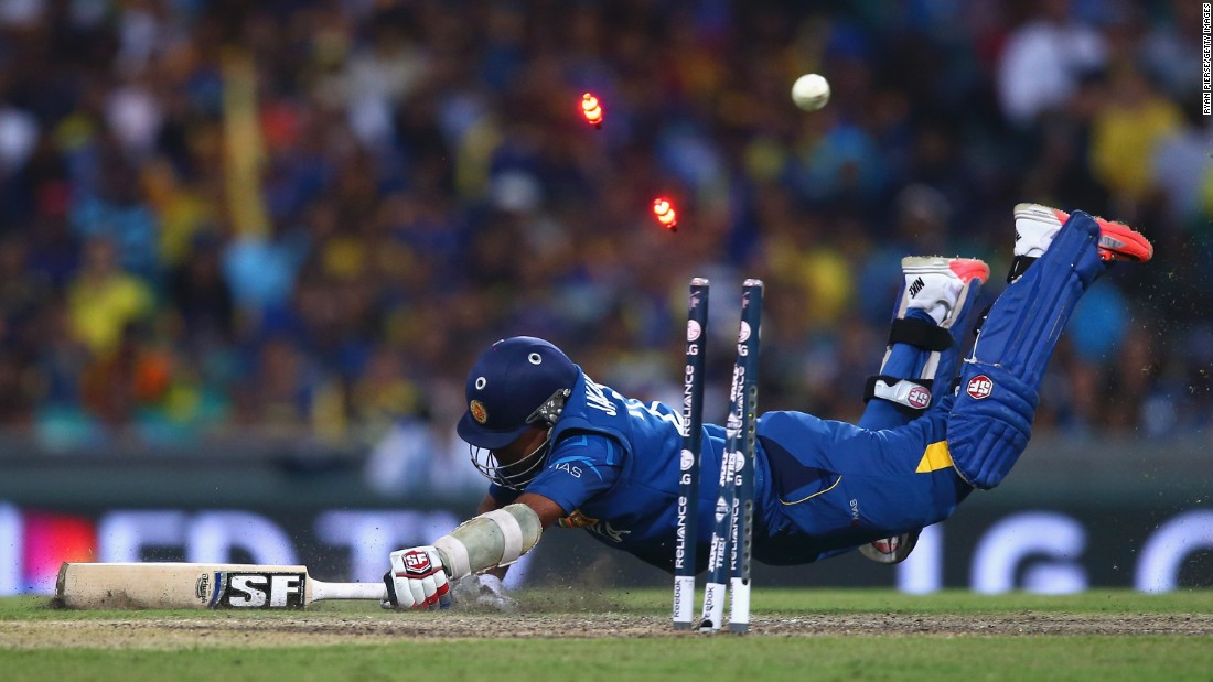 "Mahela Jayawardene of Sri Lanka is run out by Michael Clarke of Australia during a Cricket World Cup match Sunday, March 8, in Sydney. Australia won the match by 64 runs and <a href=""http://www.cnn.com/2015/03/29/sport/cricket-world-cup-final-australia/"" target=""_blank"">went on to win the tournament.</a>"