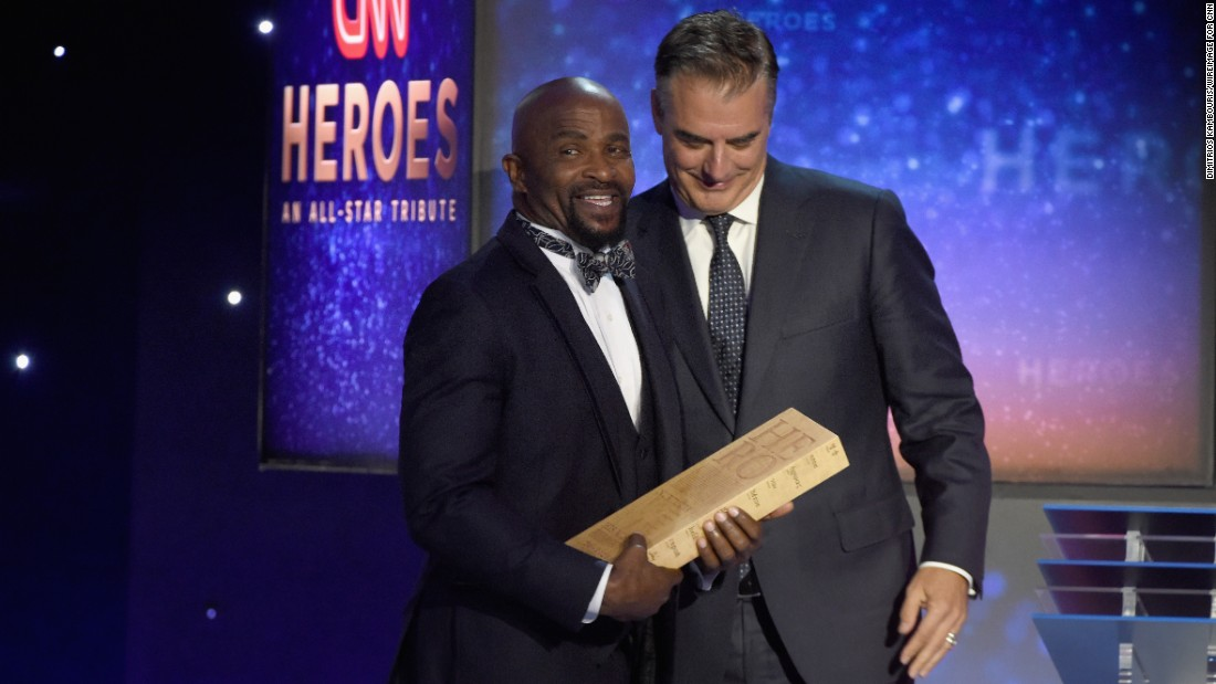 The Rev. Richard Joyner receives his award from Chris Noth. Joyner -- a 2015 Top 10 CNN Hero -- was recognized for founding an ambitious garden project aimed at improving the health of residents in and around his North Carolina community.