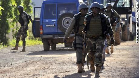 Malian troops arrive on the scene November 20.