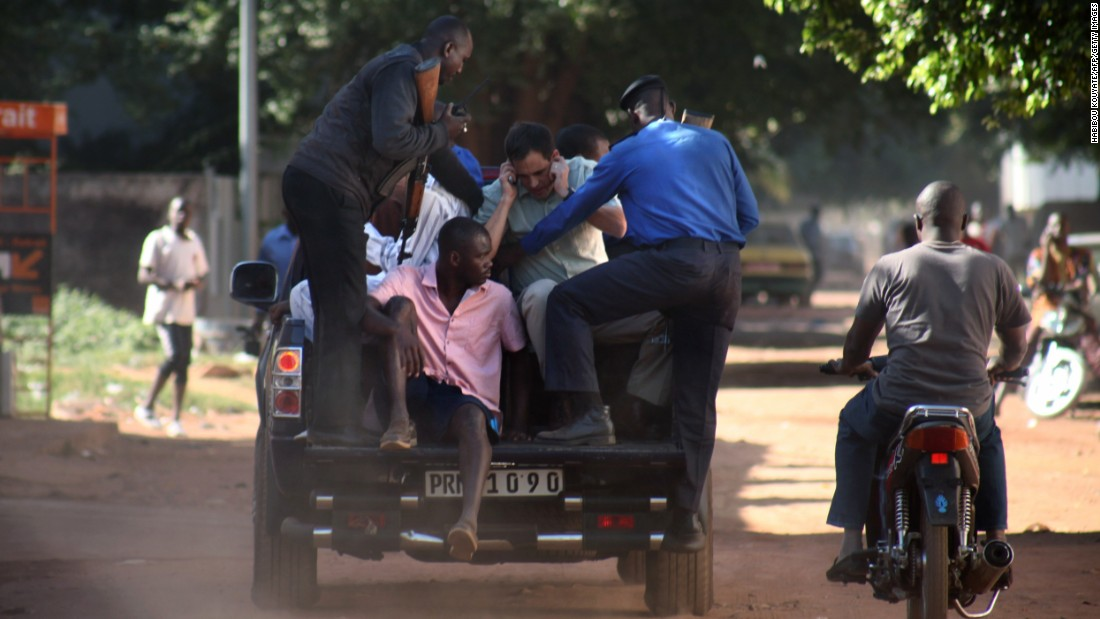 Security forces escort hostages who were freed from the Radisson Blu Hotel in Bamako, Mali, on Friday, November 20. Gunmen stormed the hotel and took 170 hostages. At least 21 deaths have been reported. No group immediately claimed responsibility for the attack.