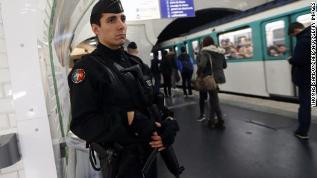 A French gendarme enforcing the Vigipirate plan, France's national security alert system, patrols on November 19, 2015 in a railway station Paris. France revealed on November 19 it will spend an extra 600 million euros (USD 641 million) next year to ramp up security after the Paris attacks. President Francois Hollande announced this week that France is freezing plans to cut troop numbers through 2019. At the same time, the country will add 8,500 law enforcement jobs including 5,000 new police. AFP PHOTO / THOMAS SAMSON        (Photo credit should read THOMAS SAMSON/AFP/Getty Images)