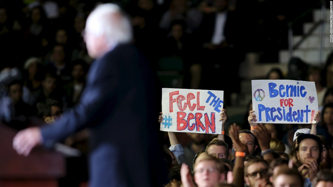 Supporters of U.S. Sen. Bernie Sanders hold up signs for him at a campaign rally in Cleveland on Monday, November 16. Sanders is seeking the Democratic Party's nomination for president.