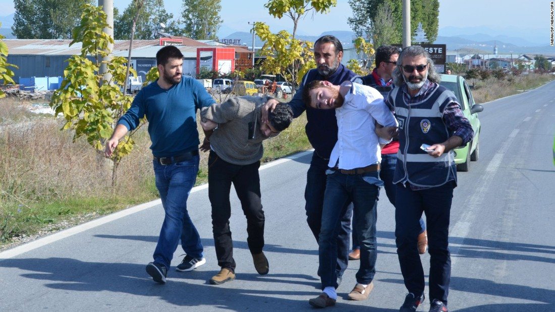 Two Syrian nationals,Ahmet Tahir, left, and Muhammed Verd, were arrested by Turkish security forces in southern Antalya province, Turkey, on November 20. They were captured, allegedly with a fake Syrian passport for Belgian national Ahmad Dahmani, suspected of location scouting for the Paris attackers.