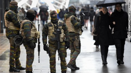Soldiers patrol the Rue Neuve pedestrian shopping street in Brussels on Saturday November 21, 2015.
