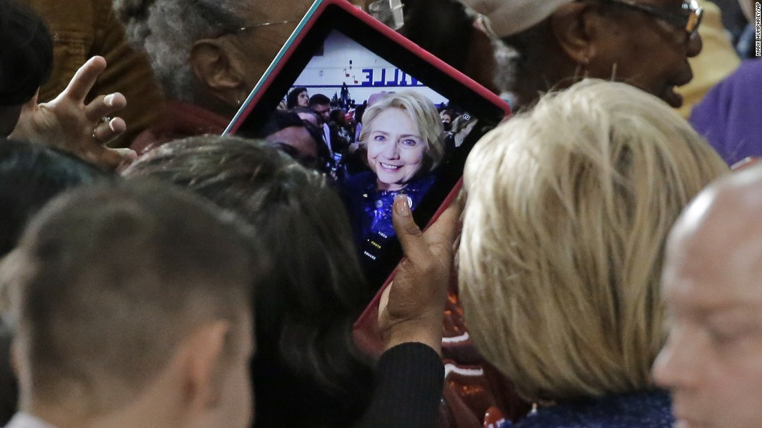 A woman takes a selfie with Democratic presidential candidate Hillary Clinton after Clinton spoke at Fisk University in Nashville, Tennessee, on Friday, November 20.