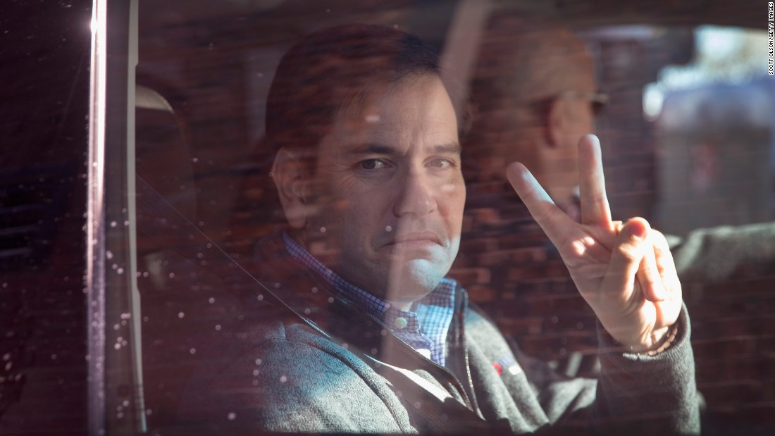 Republican presidential candidate Sen. Marco Rubio leaves Smokey Row Coffee following a campaign stop on November 21 in Oskaloosa, Iowa.