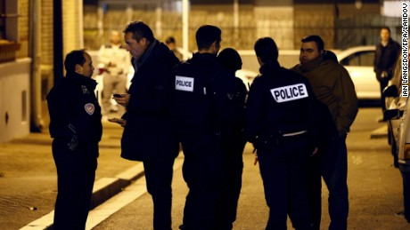 Image #: 41051959    epa05039066 French police officers stand guard in a street after an explosive belt without detonator was found in a bin in Montrouge, near Paris, France, 23 November 2015. A device found discarded in a Paris suburb is an explosive suicide belt, French prosecution sources confirmed to German news agency dpa. Police have spent a week looking for 26-year-old Salah Abdeslam, a French resident of Brussels who is believed to have taken part in the Paris terrorist attacks on 13 November 2015. He was reportedly brought back to the Brussels area by two acquaintances.  EPA/IAN LANGSDON /LANDOV