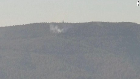 A Russian plane is seen crashing nose-first in northern Syria.