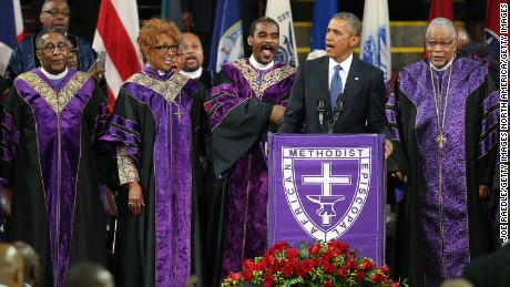 Obama sings 'Amazing Grace' during eulogy for pastor