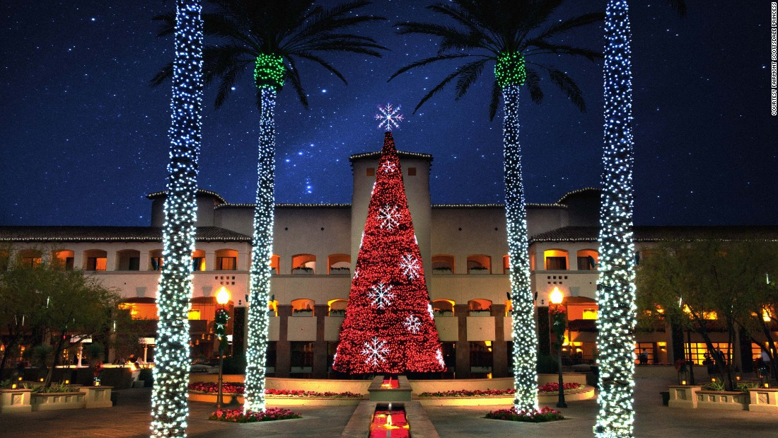 Palm trees get dressed up for Christmas at the Fairmont Scottsdale Princess in Scottsdale, Arizona.