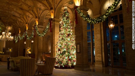 At The Breakers in Palm Beach, Florida, Christmas decorations add sparkle to the elegant interiors.