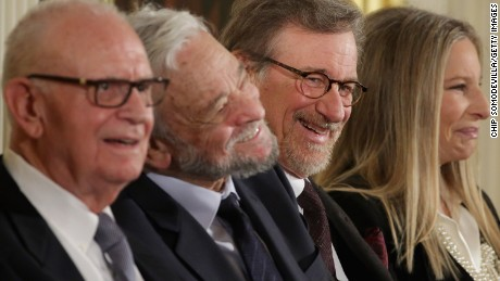 Presidential Medal of Freedom recepients (L-R) former Rep. Lee Hamilton (D-IN), musical theater legend Stephen Sondheim, filmmaker Steven Spielberg and entertainer Barbra Streisand share a laugh during a ceremony where they were presented with the honor in the East Room of the White House November 24, 2015 in Washington, DC.