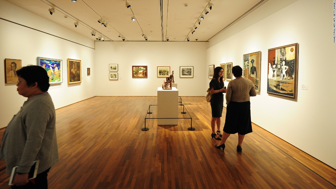 Visitors view artworks at the National Gallery Singapore, which opened on November 24, 2015.