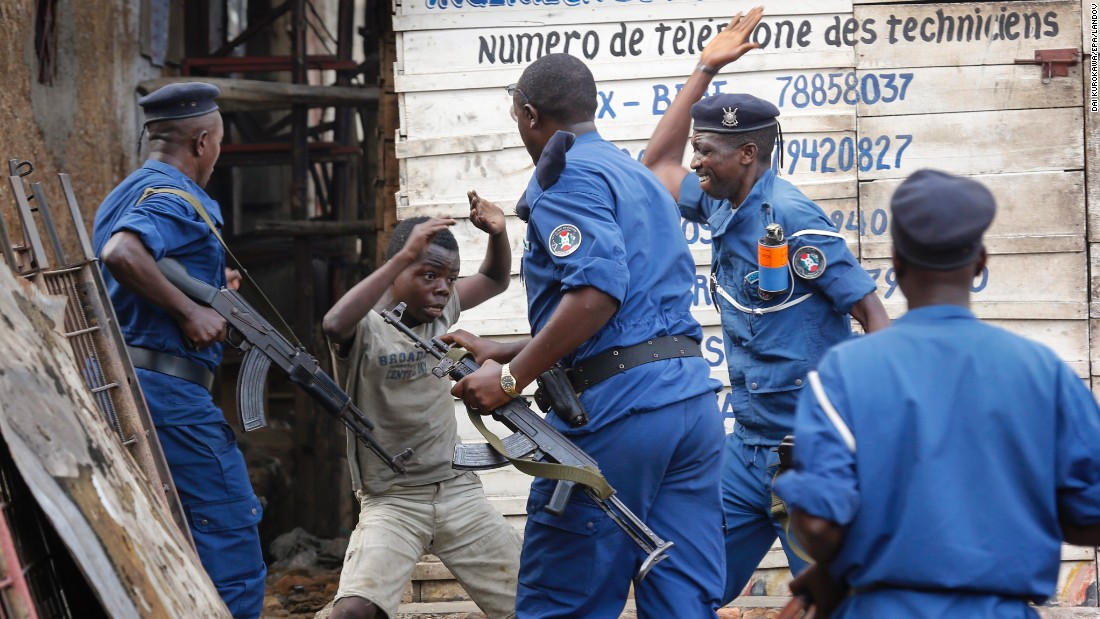 <strong>May 26:</strong> A young boy tries to cover himself as police officers beat him at an anti-government demonstration in Bujumbura, Burundi. Police fired shots to disperse people protesting against President Pierre Nkurunziza and his bid for a third term.