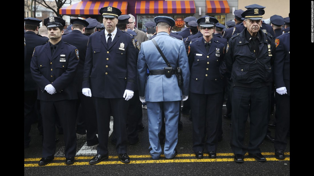 "<strong>January 4: </strong>Law enforcement officers stand outside <a href=""http://www.cnn.com/2015/01/04/us/gallery/liu-funeral/index.html"" target=""_blank"">the funeral of fallen New York police officer Wenjian Liu.</a> Some officers turned their backs while New York Mayor Bill de Blasio spoke on a monitor. <a href=""http://www.cnn.com/2014/12/22/politics/de-blasio-police-shooting/index.html"" target=""_blank"">The mayor's critics</a> believed his comments after the death of Eric Garner contributed to an anti-police sentiment that led to the shootings of Liu and his partner, Rafael Ramos."