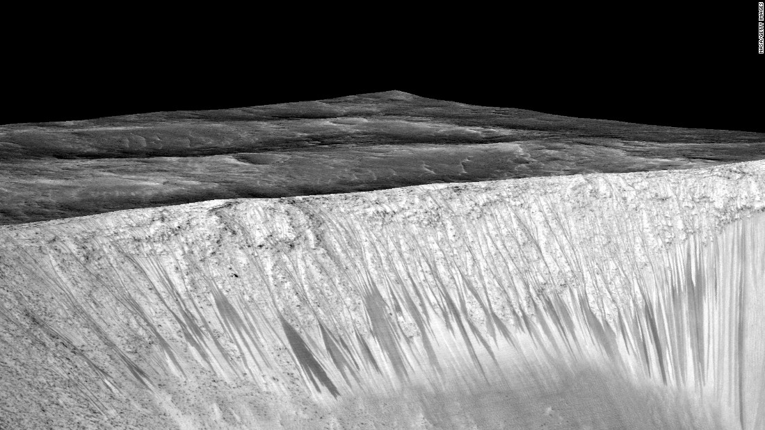 NASA's Mars Reconnaissance Orbiter captures the Garni Crater. The dark, narrow streaks are said to be formed by a flow of water on the surface of present-day Mars.