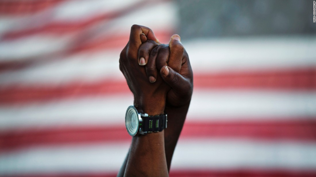 "<strong>June 21:</strong> People join hands in Charleston, South Carolina, as thousands march on the Arthur Ravenel Jr. Bridge. Marchers joined hands to show unity after <a href=""http://www.cnn.com/2015/06/18/us/gallery/charleston-south-carolina-church-shooting/index.html"" target=""_blank"">a church shooting</a> killed nine black parishioners in Charleston several days earlier. Suspect Dylann Roof was captured in North Carolina the day after the attack. He confessed in interviews with the Charleston police and FBI, two law enforcement officials told CNN. He also told investigators he wanted to start a race war, one of those officials said. Roof <a href=""http://www.cnn.com/2015/07/31/us/dylann-roof-not-guilty-plea-charleston-church-shooting/"" target=""_blank"">pleaded not guilty</a> to 33 federal charges in July."
