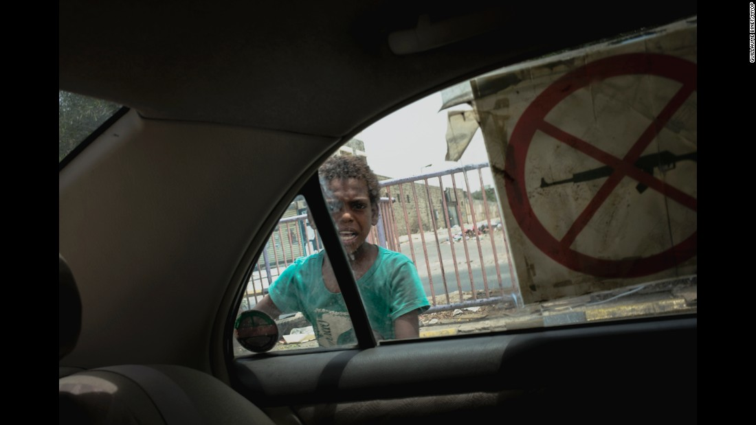 """<strong>June 27:</strong> A child is seen through a car window in Aden, Yemen. The port city <a href=""""http://www.cnn.com/2015/07/30/world/cnnphotos-aden-yemen-besieged/index.html"""" target=""""_blank"""">has been under siege</a> since March, when Houthi rebels forced out President Abdu Rabu Mansour Hadi. """"People in the city center have been shelled for a few months,"""" photographer Guillaume Binet said."""