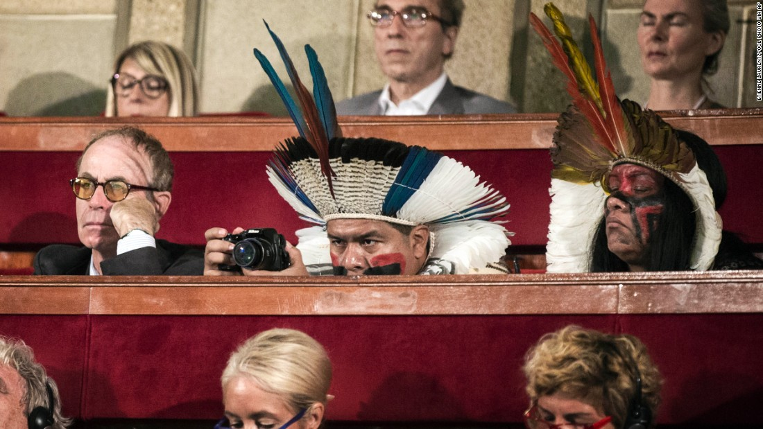 <strong>July 21:</strong> Delegates, some in traditional dress, attend the opening of a climate summit in Paris. French President Francois Hollande called for an ambitious accord ahead of a United Nations conference to address the threat of global warming.