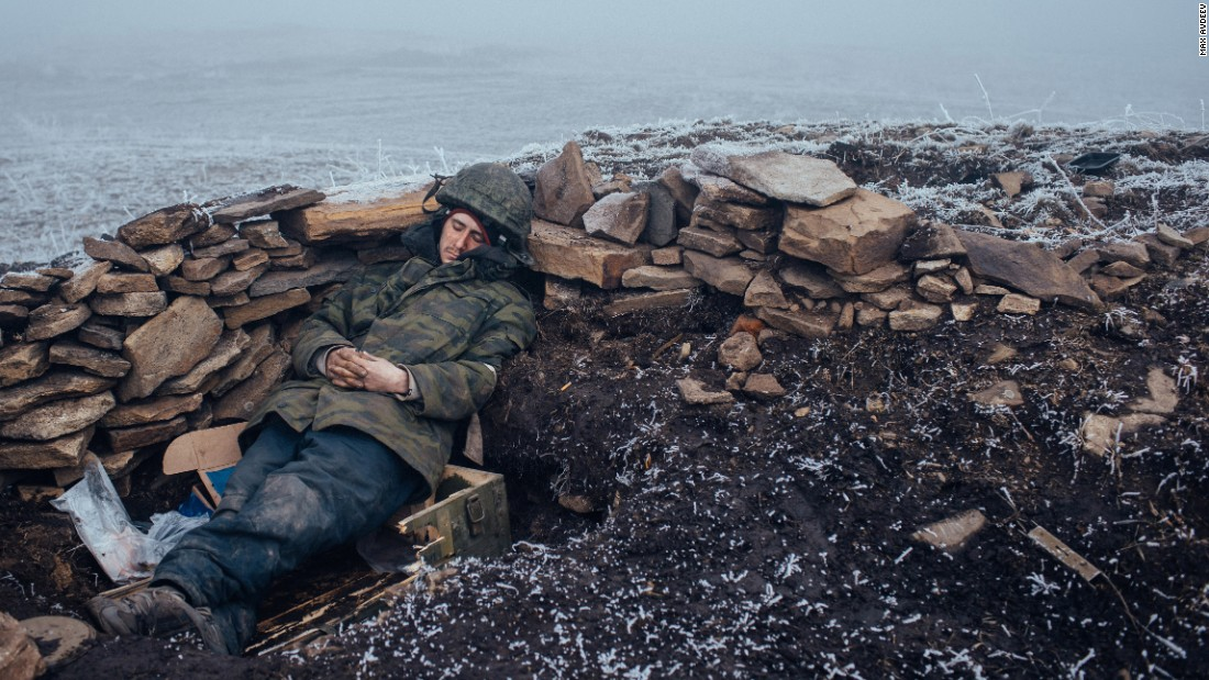 "<strong>February 15:</strong> A pro-Russian rebel rests in Debaltseve, Ukraine, one day after a skirmish with Ukrainian troops. <a href=""http://www.cnn.com/2015/03/02/europe/ukraine-death-toll/"" target=""_blank"">Fighting between Ukrainian troops and pro-Russian rebels</a> has left more than 6,000 people dead since April 2014, according to the United Nations. A recent ceasefire, the so-called Minsk Agreement, has been repeatedly violated."